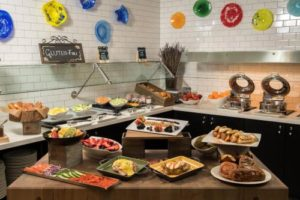 a catering array of fruits, vegetables, bread